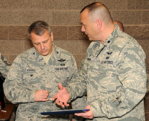 Lt. Col. Troy Drennan, 169th Intelligence Squadron Commander, brainstorms with  Col. John Knabel, Chief, Intelligence, Surveillance, Reconnaissance Forces  Division, Air National Guard, National Guard Bureau, during a break between  sessions at the Weapons Systems Council Conference held at Roland R. Wright  Air National Guard Base February 2-3. More than two dozen members of the  intelligence community gathered from across the nation to discuss existing and  emerging issues. (Air National Guard photo by Capt. Jennifer Eaton/RELEASED)