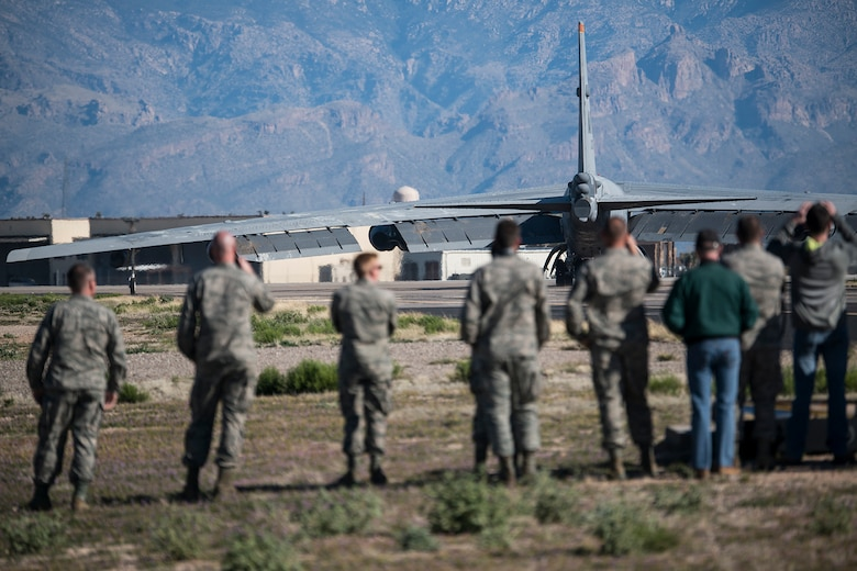 "U.S. Air Force Airmen watch a B-52H Stratofortress taxi for takeoff after being taken out of long term storage at the 309th Aerospace Maintenance and Regeneration Group, Feb. 13, 2015, Davis-Monthan Air Force Base, Arizona. The aircraft was decommissioned in 2008 and has spent the last seven years sitting in the ""Boneyard,"" but was selected to be returned to active status and will eventually rejoin the B-52 fleet. (U.S. Air Force photo by Master Sgt. Greg Steele/Released)"