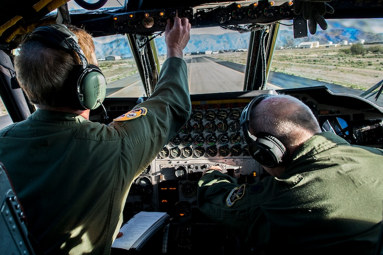 "U.S. Air Force Col. Keith Schultz and Lt. Col. Tim Hines, prepare for the engine start of a B-52H Stratofortress on Feb. 12, 2015, Davis-Monthan Air Force Base, Ariz. The B-52 was decommissioned in 2008 and has spent the last seven years in 1000-type storage in the ""Boneyard,"" but is being restored and will eventually join the active B-52 fleet. (U.S. Air Force photo by Master Sgt. Greg Steele/Released)"