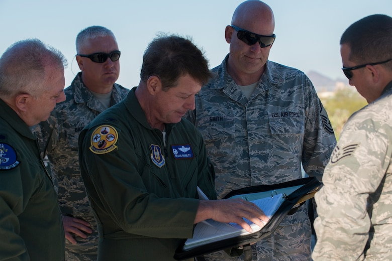 "U.S. Air Force Col. Keith Schultz, 307th Operations Group commander, looks over the aircraft forms of a B-52H Stratofortress before a flight on Feb. 13, 2015, Davis-Monthan Air Force Base, Ariz. Schultz, who has over 6,500 flying hours in the B-52, will pilot the aircraft on its flight from the ""Boneyard"" since sitting in storage for seven years after being decommissioned in 2008. (U.S. Air Force photo by Master Sgt. Greg Steele/Released)"