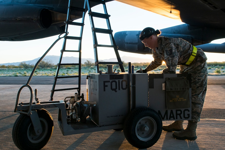 "U.S. Air Force Tech. Sgt. Suann Becton, a 565th Aircraft Maintenance Squadron crew chief, services a B-52H Stratofortress before its flight on Feb. 13, 2015, Davis-Monthan Air Force Base, Ariz. Becton is a member of the maintenance team that regenerated aircraft 61-007 after spending the last seven years in 1000-type storage at the 309th Aerospace Maintenance and Regeneration Group's ""Boneyard."" (U.S. Air Force photo by Master Sgt. Greg Steele/Released)"