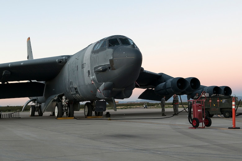 "Maintenance personnel prepare a B-52H Stratofortress for its first flight in seven years on Feb. 13, 2015, Davis-Monthan Air Force Base, Ariz. The aircraft, known as the ""Ghost Rider,"" was decommissioned in 2008 and was selected to return to active status and will eventually rejoin the B-52 fleet. (U.S. Air Force photo by Master Sgt. Greg Steele/Released)"