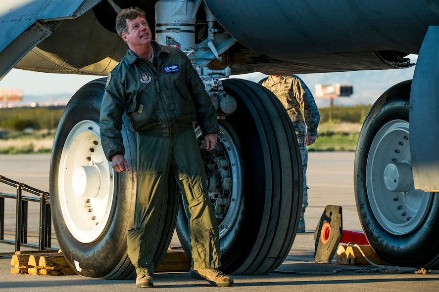 """U.S. Air Force Col. Keith Schultz, 307th Operations Group commander, performs a preflight inspection of a B-52H Stratofortress before a taxi test on Feb. 12, 2015, Davis-Monthan Air Force Base, Ariz. Schultz, who has over 6,500 flying hours in the B-52, will pilot the aircraft on its flight from the """"Boneyard"""" since sitting in storage for seven years after being decommissioned in 2008. (U.S. Air Force photo by Master Sgt. Greg Steele/Released)"""