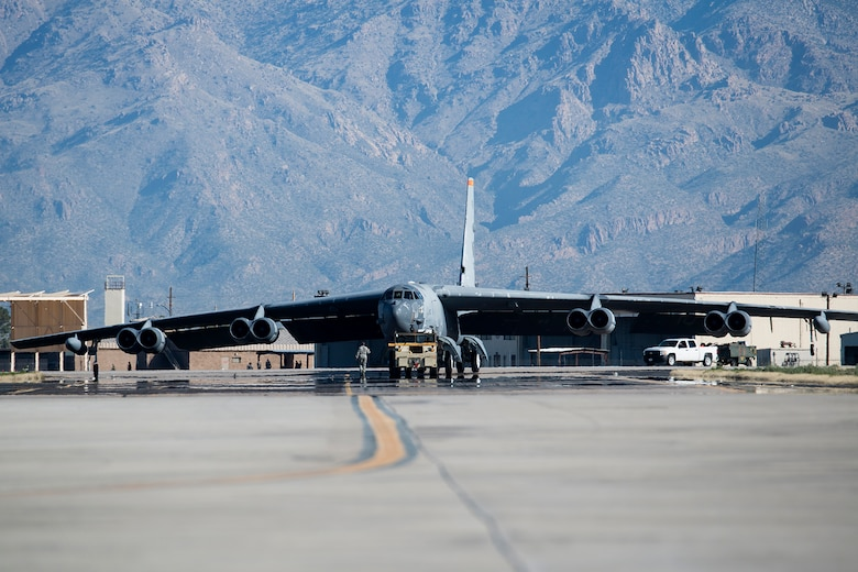 "A U.S. Air Force B-52H Stratofortress is towed from a maintenance area at the 309th Aerospace Maintenance and Regeneration Group, Feb. 11, 2015, Davis-Monthan Air Force Base, Ariz. The aircraft, tail number 61-1007 and known as the ""Ghost Rider,"" is being regenerated for active service after sitting in storage since 2008 when it was decommissioned and sent the Boneyard. (U.S. Air Force photo by Master Sgt. Greg Steele/Released)"