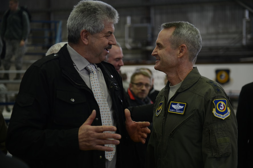 U.S. Air Force Lt. Gen. Darryl Roberson, 3rd Air Force and 17th Expeditionary Air Force commander, interacts with Klaus Rodens, mayor of Spangdahlem, during a theater security package announcement at Spangdahlem Air Base, Germany, Feb. 18, 2015. During the announcement, Roberson spoke about the importance of the host nation relationship and the local community to the TSP rotational deployments. (U.S. Air Force photo by Senior Airman Gustavo Castillo/Released)