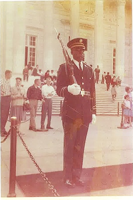 "Then-Spc. 4th Class Fred Moore faces the Tomb of the Unknown Soldier at Arlington National Cemetery in Virginia during his relief walk in 1961. Moore was the first African American soldier to ""walk the mat"" at the Tomb. Photo courtesy of Fred Moore"