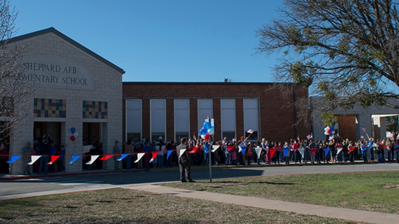 Survivors from the battle of Iwo Jim are greetied by students as they arrive at Sheppard Air Force Base Elementary School for the 70th Anniversary Iwo Jima Veteran's Program performed by students of the school at Sheppard Air Force Base, Texas, February 13, 2015. Survivors enjoyed special songs performed by the Sheppard Choir and poems written and recited by sixth grade students.
