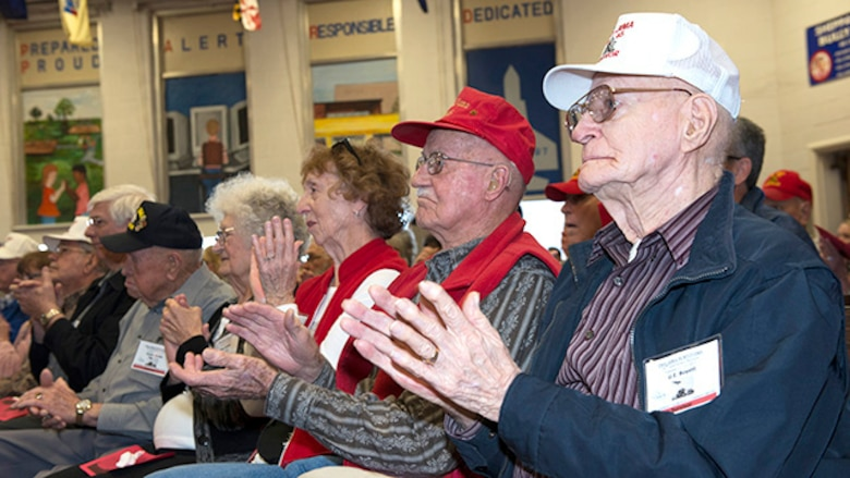 Survivors from the battle of Iwo Jima applaud after a song performed by the students of the Sheppard Choir at Sheppard Air Force Base Elementary School during the 70th Anniversary Iwo Jima Veteran's Program at Sheppard Air Force Base, Texas, February 13, 2015. The survivors enjoyed special songs and poems written and recited by sixth grade students.