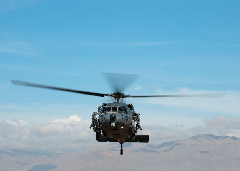 An HH-60G Pave Hawk assigned to the 66th Rescue Squadron takes off for a training exercise Jan. 12, 2015, at Nellis Air Force Base, Nev. The 823rd Maintenance Squadron is responsible for maintaining the aircraft and ensuring they are mission ready for the 66th and 58th Rescue Squadrons to carry out their combat search and rescue operations. (U.S. Air Force photo/Senior Airman Thomas Spangler)