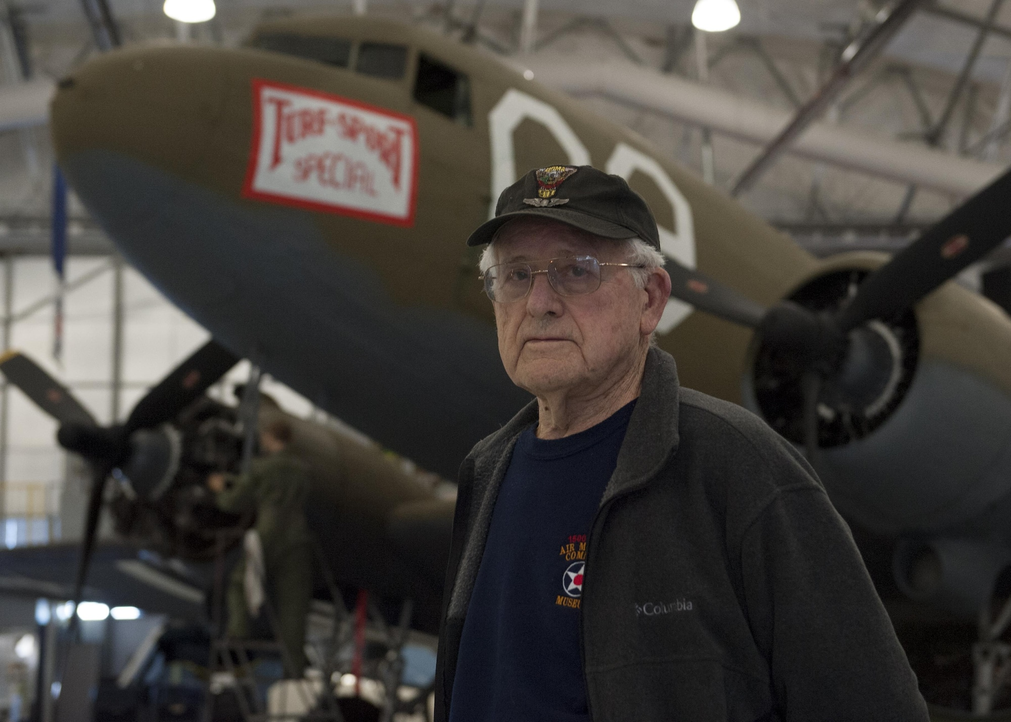 Don Clark poses in front of a C-47A Skytrain Jan. 28, 2015, at the Air Mobility Command Museum on Dover Air Force Base, Del. During World War II, Clark piloted C-47A and flew 81 missions, to include 27 combat missions. (U.S. Air Force photo/Airman 1st Class Zachary Cacicia)