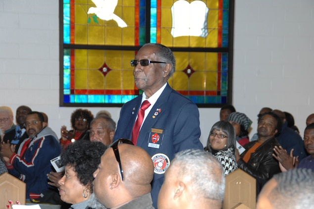 Montford Point Marine Henry L. Jackson stands during recognition of his contributions to the Marine Corps at the annual Black History Month observance held at Marine Corps Logistics Base Albany's Chapel of the Good Shepherd, Feb. 19.