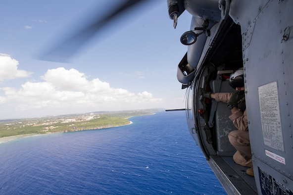 U.S. Navy Naval Aircrewmen (Helicopter) Second Class Veditz from Helicopter Sea Combat Squadron Two-Five, scans the horizon during a multinational search and rescue exercise at Cope North 15, Feb. 18, 2015, off the coast of Guam. Exercise Cope North 15 enhances humanitarian assistance and disaster relief crisis response capabilities between six nations and lays the foundation for regional cooperation expansion during real-world contingencies in the Asia-Pacific Region.(U.S. Air Force photo by Tech. Sgt. Jason Robertson/Released)