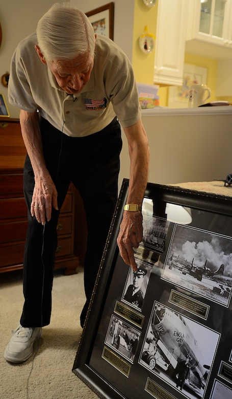 Russell Gackenbach, former B-29 Superfortress navigator, shows photographs from the bombing on Hiroshima, Japan, Feb 10, 2015, Clearwater, Fla.  Gackenbach is credited with taking some of the only photos of the first atomic bomb used in combat. (U.S. Air Force photo by Tech. Sgt. Brandon Shapiro/Released).