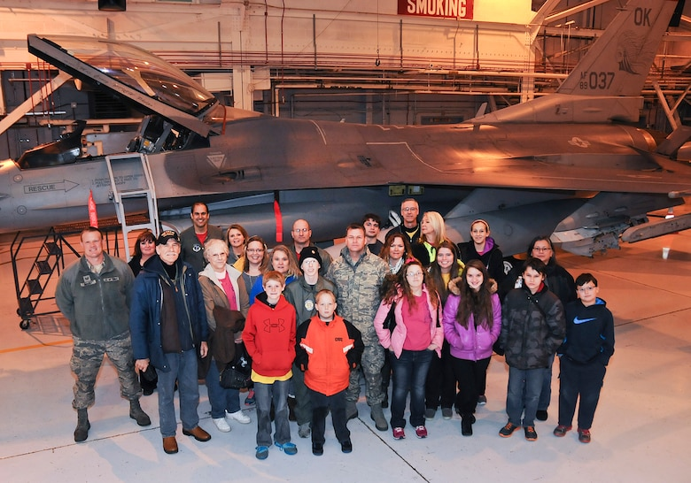 "Josh Payton, 138th Fighter Wing's ""pilot for a day"" stand with family and friends during his visit as an honored guest Feb. 19, 2015, at the Tulsa Air National Guard base, Tulsa, Okla.  The pilot for a day program is intended to recognize and honor children with potentially life threatening illnesses and started at the 138th in May 2012, and has hosted seven children since it began.  (U.S. National Guard photo by Senior Master Sgt.  Preston L. Chasteen/Released)"