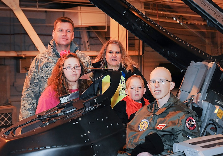 "Josh Payton, 138th Fighter Wing's ""pilot for a day"" with parents A1C Jacky Payton and wife Marie, sister Gracie and brother Jared during his visit as an honored guest Feb. 19, 2015, at the Tulsa Air National Guard base, Tulsa, Okla.  The pilot for a day program is intended to recognize and honor children with potentially life threatening illnesses and started at the 138th in May 2012, and has hosted seven children since it began.  (U.S. National Guard photo by Senior Master Sgt.  Preston L. Chasteen/Released)"