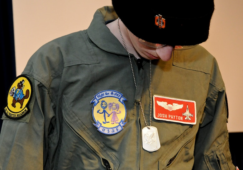 "Josh Payton, ""pilot for a day"" admires his new dog tags while serving as an honored guest of the 138th Fighter Wing Feb. 19, 2015, at the Tulsa Air National Guard base, Tulsa, Okla.  The pilot for a day program is intended to recognize and honor children with potentially life threatening illnesses and started at the 138th in May 2012, and has hosted seven children since it began.  (U.S. National Guard photo by Senior Master Sgt.  Preston L. Chasteen/Released)"