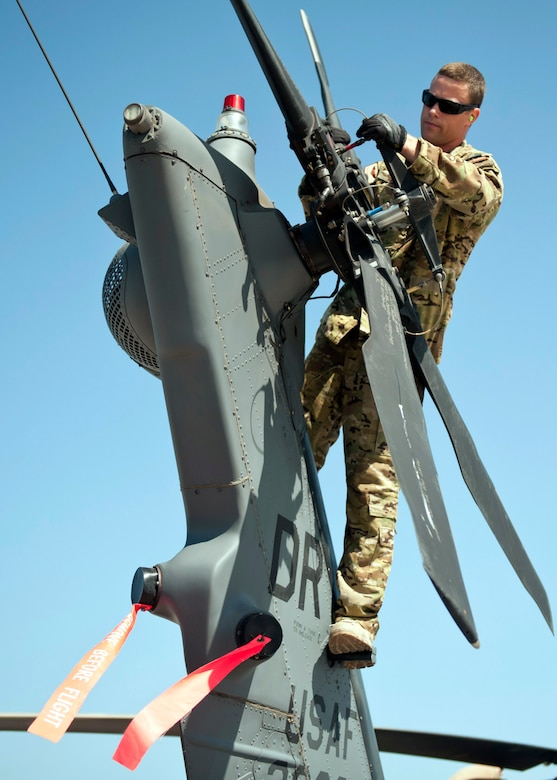 U.S. Air Force Tech. Sgt. Caleb Hiner, 303rd Expeditionary Rescue Squadron special mission aviator, inspects the tail motor on an HH-60 Pave Hawk during a preflight inspection at Camp Lemonnier, Djibouti on Jan. 26, 2015. During the preflight checks, the aviators look for serviceability and to ensure the aircraft is ready to fly when they are called for a mission. (U.S. Air Force photo by Staff Sgt. Kevin Iinuma)