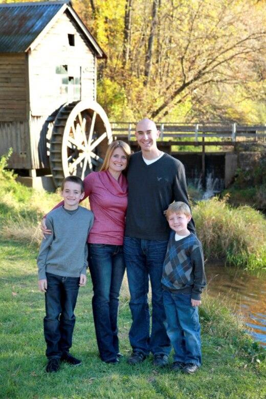 Senior Master Sgt. Craig A. Mortvedt, Cheryl (Wife), Riley (Son, 11) and Alex (Son, 7).  (Photo courtesy of Tina Bazala Photography)