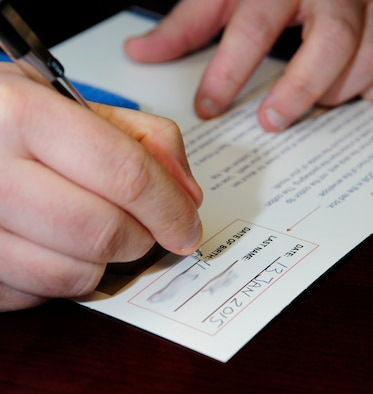 A man fills out a form.