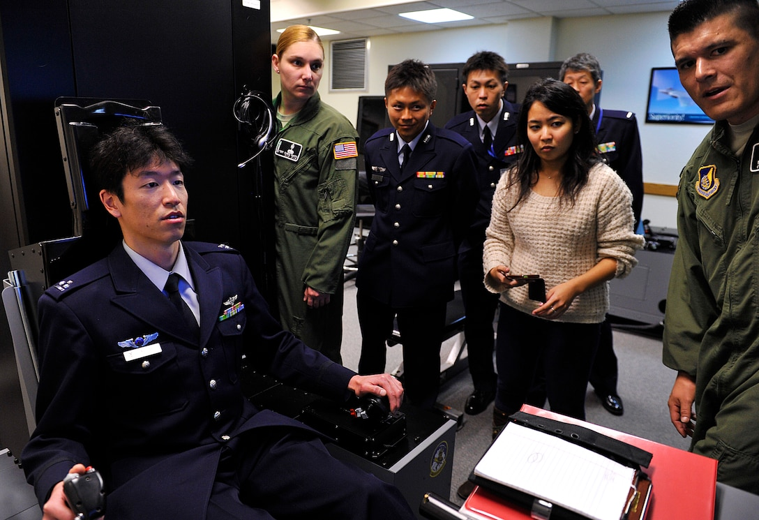 Japan Air Self-Defense Force Capt. Makoto Inada, 4th Division, Aeromedical Laboratory flight surgeon, participates in the demonstration of a Hypoxia Familiarization Trainer on Kadena Air Base, Japan, Feb. 12, 2015. The JASDF Aeromedical Laboratory personnel perform aviation-related medical and psychological research, physiological training and physical examination of aircrew, and support technical research and development. (U.S. Air Force photo by Naoto Anazawa)