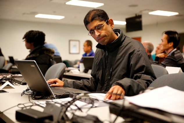 Sundar Sitaraman, a mechanical systems engineer who supports Advanced Amphibious Assault at Program Executive Officer Land Systems, studies the ADAMS software that simulates loads and forces on large equipment. He was in a class with other engineers from Marine Corps Systems Command and PEO LS that learned industry standards to gauge machine performance. (U.S. Marine Corps Photo by Jim Katzaman)