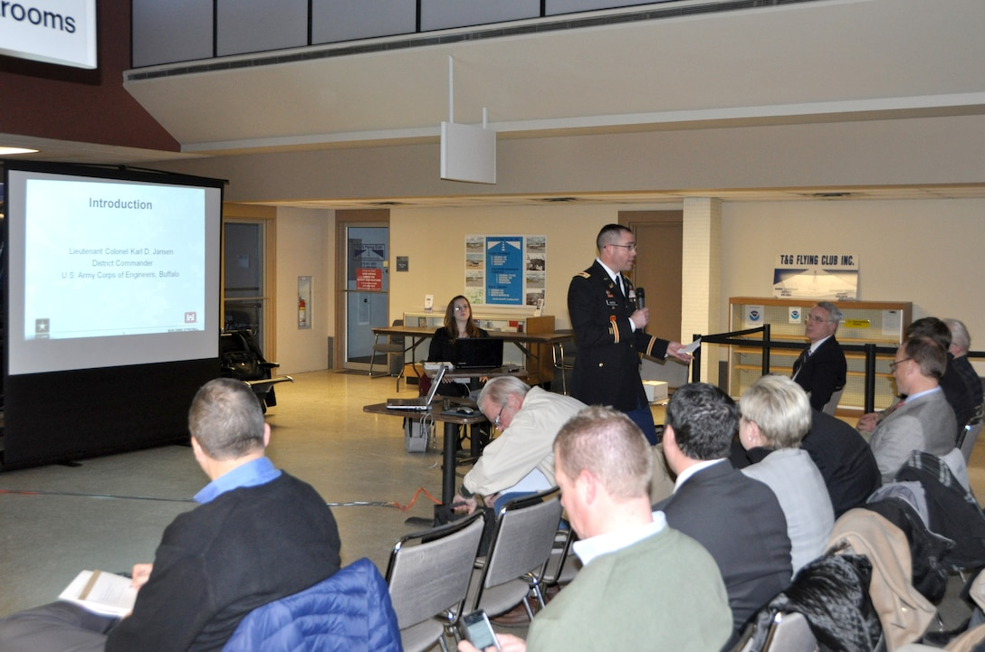 U.S. Army Corps of Engineers, Buffalo District Commander LTC Karl Jansen provides opening remarks at the public hearing regarding the dredging of Cleveland Harbor at Burke Front Airport, Cleveland, OH, February, 19, 2015.