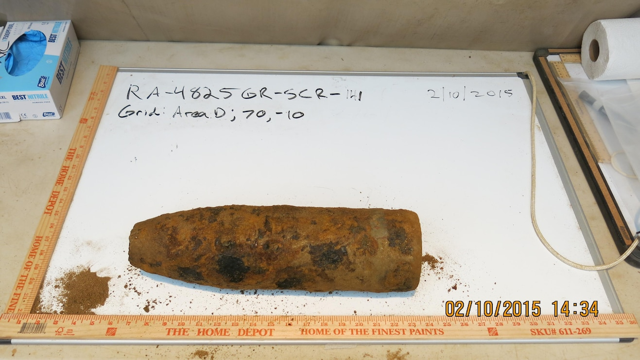 "On February 10, 2015 crews safely recovered two open cavity, unfired, unfuzed, empty 4.7"" projectiles (just one pictured here). Both items were non-detect for chemical agent and are being handled as munitions debris."