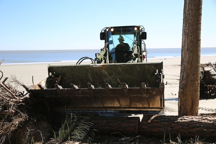 Marines with Marine Wing Support Squadron 273 assisted in the beautification of Hunting Island Beach, St. Helena Island, S.C., Feb. 17-20. Marines with MWSS-273 are using their equipment to help with erosion control by removing man-made and natural debris. Approximately thirty Marines and a Navy Corpsman from MWSS-273, also known as the Sweathogs, cleared dead trees, cleaned up debris and dug out rotting stumps in an effort to help out the community. South beach, north beach and the camp grounds were some of the areas cleared.