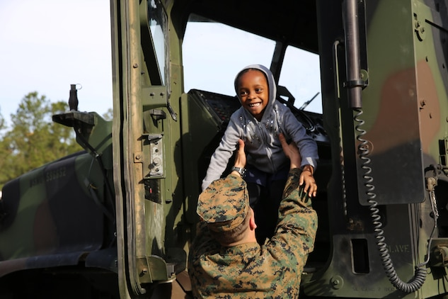 Marines from Marine Corps Air Station Beaufort visited Michael C. Riley elementary school to educate students about different military careers. Marine Wing Support Squadron 273 brought several vehicles from their motor pool for students to see and even climb aboard and blow the horn.