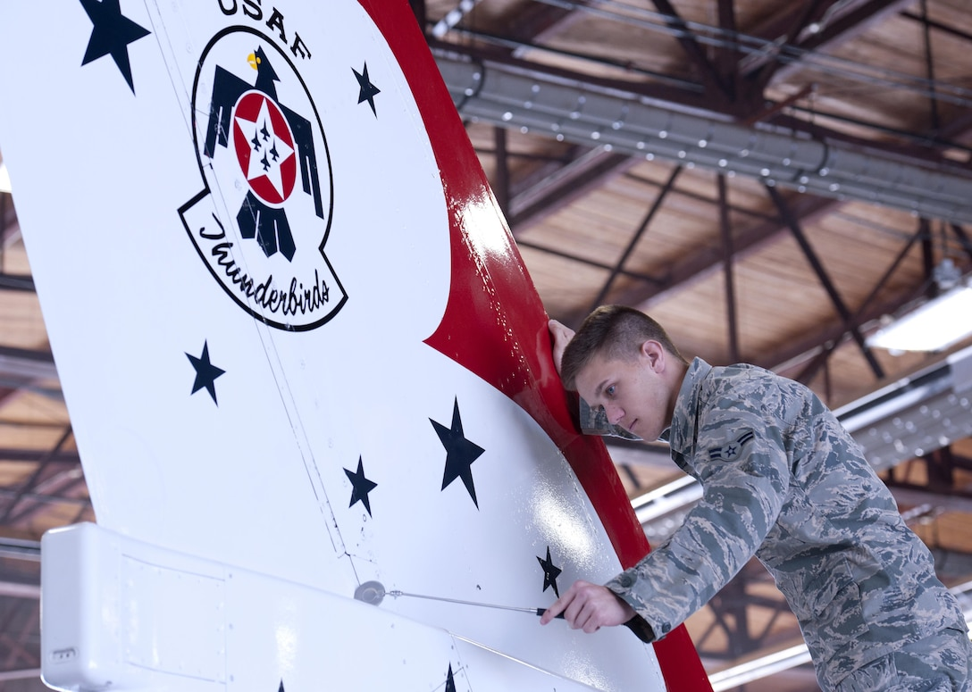 Airman 1st Class Justin Kesler, 362nd Training Squadron Aerospace Maintenance Course student, performs a maintenance inspection on a Thunderbird F-16 Fighting Falcon trainer Feb. 12, 2015 at Sheppard Air Force Base, Texas. Students inspect for faults and damages and make necessary repairs before the aircraft is ready to fly.  (U.S. Air Force Photo by Danny Webb)