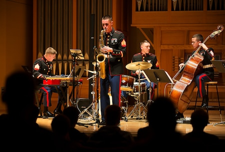 """Marine Band San Diego's jazz combo performs during a concert for Central Washington University students in Ellensburg, Washington, Feb. 17, 2015. Following an intensive audition and screening process, Marine Band applicants attend recruit training and Marine Combat Training. Next, they attend a six-month basic music course at the Armed Forces School of Music in Norfolk, Virginia, where they study theory, ear training, private instrumental lessons, ensemble instruction and marching techniques. When their initial training is complete, they are assigned to one of 12 field bands in the continental U.S., Hawaii or Japan. The Marine Corps also supports """"The Commandant's Own"""" Drum & Bugle Corps and """"The President's Own"""" United States Marine Band. (U.S. Marine Corps photo by Sgt. Reece Lodder)"""