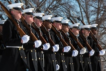 United States Marines from Marine Barracks, Washington, D.C., march in the Relief and Appointment Ceremony in honor of the outgoing Sergeant Major of the Marine Corps, Sgt. Maj. Micheal P. Barrett, and the incoming, Sgt. Maj. Ronald L. Green, at the Marine Corps War Memorial in Arlington, Va. on February 20, 2015. (U.S. Marine Corps photo by Lance Cpl. Christian J. Varney/Released)