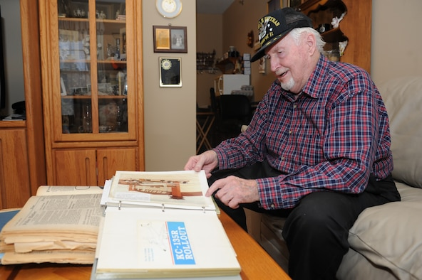 Glen Mishler, Air Force veteran and former Boeing mechanic, skims through a scrapbook of memorabilia highlighting important events from his life Feb. 18, 2015 in Andover, KS. Mishler was part of a test crew for the first KC-135Rs that eventually arrived at McConnell Air Force Base, KS, in 1984.