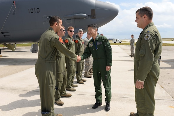 Lt. Gen. Yoshinari Marumo, Western Air Self- Defense Force commander, greets deployed Airmen from the 2nd Bomb Wing, Barksdale Air Force Base, LA, on the airfield during a tour of the base Feb. 19, 2015, at Andersen AFB, Guam. The Japan Air Self-Defense Force has eight Mitsubishi F-2s, six F-15 eagles, two E-2 Hawkeyes, 1 U-125, 2 Boeing KC-767s and one C-130 Hercules, deployed here in support of Cope North 2015, a multilateral training exercise which is a long-standing, multinational event designed to increase interoperability and improve combat readiness and develop a synergistic disaster response capability between the countries involved.  (U.S. Air Force photo by Senior Airman Cierra Presentado/Released)