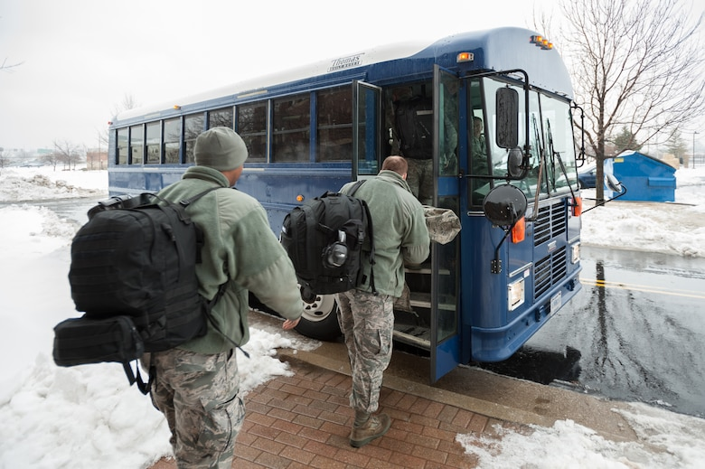 Members of the 123rd Airlift Wing board a bus that will take them to their C-130 Hercules aircraft at the Kentucky Air National Guard Base in Louisville, Ky., Feb. 21, 2015. The Airmen are heading to the Persian Gulf for a four-month deployment in support of Operation Freedom's Sentinel. (U.S. Air National Guard photo by Maj. Dale Greer)