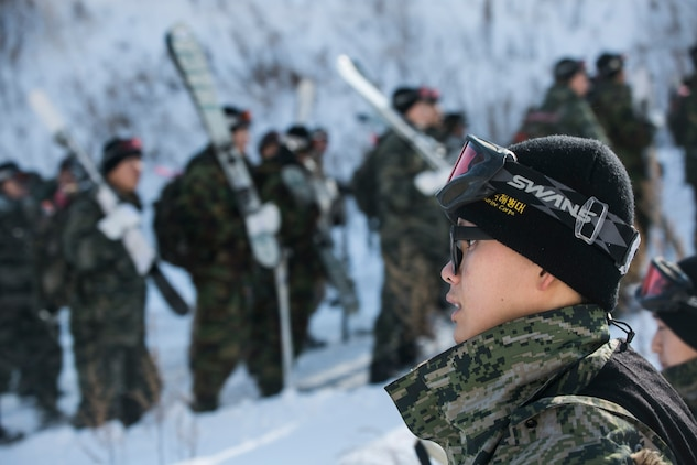 Republic of Korea Marines walk to the ski slopes during Korean Marine Exchange Program 15-3 Jan. 23 in Pyeongchang, Republic of Korea. They learned both basic and advanced skiing techniques, like skiing with a pack on or skiing with a weapon in hand. The ROK Marines are with Alpha Company, 2nd Battalion, 2nd Marine Division.