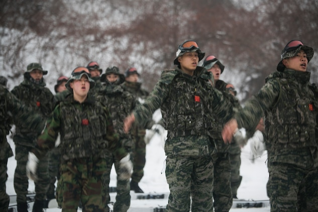 Republic of Korea Marines warm up for snow mobility training during Korean Marine Exchange Program 15-3  Jan. 26 in Pyeongchang, Republic of Korea. The Marines were learning to ski for snow mobility training as part of mountain warfare training. Training included stopping, turning, proper falling techniques and how to quickly climb back up slopes with skis on. The ROK Marines are force reconnaissance men with Alpha Company, 2nd Battalion, 2nd Marine Division.