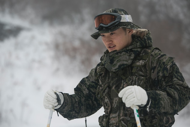 A Republic of Korea Marine pratices stopping while on skis during Korean Marine Exchange Program 15-3  Jan. 26 in Pyeongchang, Republic of Korea. U.S. and ROK Marines went through snow mobility training as a part of mountain warfare training. Training included stopping, turning, proper falling techniques and how to quickly climb up slopes with skis on. The ROK Marine is a force reconnaissance man with Alpha Company, 2nd Battalion, 2nd Marine Division.