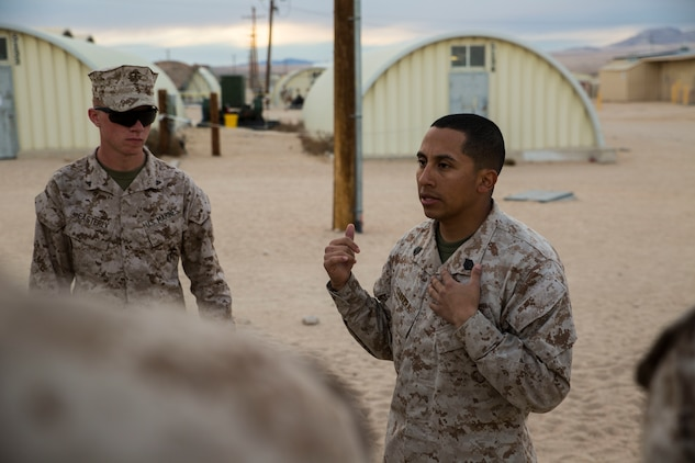"""Staff Sgt. Absalon A. Cabrera (Right) debriefs his Marines after training Jan. 21 at Marine Air Ground Combat Center Twentynine Palms, California, during Integrated Training Exercise 2-15. """"To bring a different group of Marines together and have them do the same thing an infantry unit would do is great,"""" said Cabrera. """"The Marines have met that standard here."""" Cabrera, an infantry unit leader, and Los Angeles, California, native, is the convoy commander for the 4th Marine Regiment jump team. ITX 2-15 is designed to integrate combined arms and improve warfighting capabilities. Cabrera is with Headquarters Company, 4th Marines, 3rd Marine Division, III Marine Expeditionary Force."""