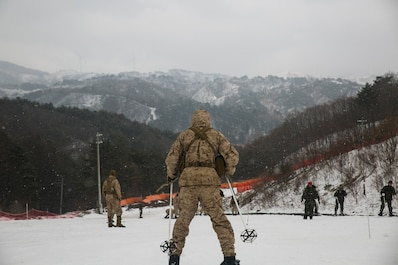 U.S. Marine Cpl. Matthew G. Smith practices skiing downhill during Korean Marine Exchange Program 15-3 Jan. 28 in Pyeongchang, Republic of Korea. The Marines were practicing basic and advanced skiing techniques alongside Republic of Korea Marines. Smith is a reconnaissance man with Alpha Company, 3rd Reconnaissance Battalion, 3rd Marine Division, III Marine Expeditionary Force.