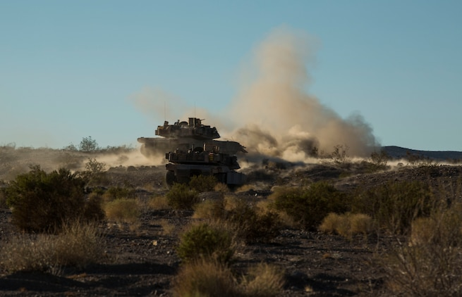Marines fire at objectives to repel a simulated enemy assault Feb. 9 at Marine Air Ground Combat Center Twentynine Palms, California, during the battalion assault course at Integrated Training Exercise 2-15. M1A1 Abrams Main Battle Tanks fire a 120 mm cannon to provide direct and indirect fire to allow ground forces to assault an objective. The Marines operating the Abrams are with Company D, 1st Tank Battalion, 1st Marine Division, I Marine Expeditionary Force.