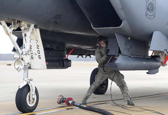 An Airman prepares an F-15E Strike Eagle for hot pit refueling Feb. 10, 2015, at Seymour Johnson Air Force Base, N.C. Hot pit refueling alleviates stress on an aircraft's engines by reducing the number of times they are switched on and off. The Airmen is assigned to the 335th Aircraft Maintenance Unit and the F-15E is assigned to the 335th Fighter Squadron. (U.S. Air Force photo/Senior Airman Ashley J. Thum)
