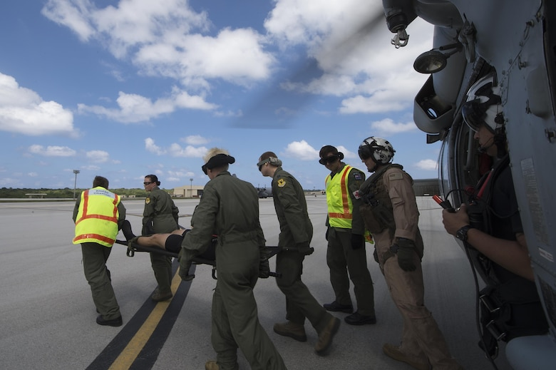 Aeromedical personnel from the U.S. Air Force and Royal Australian air force, transfer a simulated downed pilot from a U.S. Navy MH-60S Knighthawk during a multinational search and rescue exercise at Cope North 15, Feb. 18, 2015, at Anderson Air Force Base, Guam. Exercise Cope North 15 enhances humanitarian assistance and disaster relief crisis response capabilities between six nations and lays the foundation for regional cooperation expansion during real-world contingencies in the Asia-Pacific Region. (U.S. Air Force photo/Tech. Sgt. Jason Robertson)
