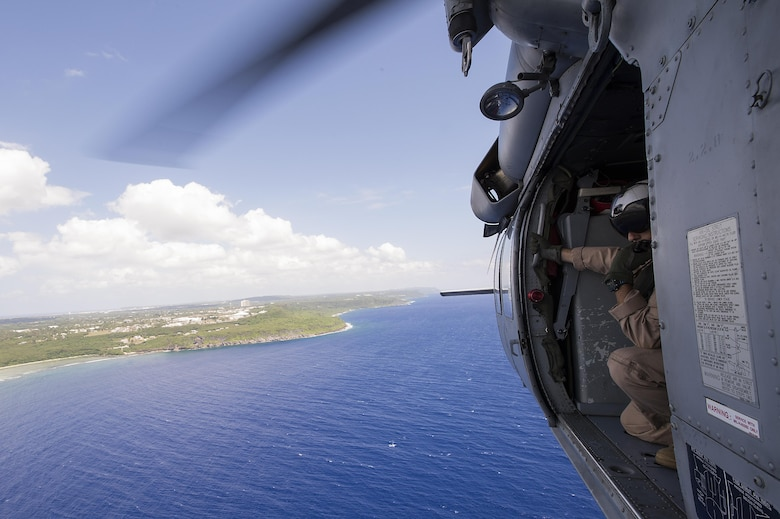 U.S. Naval Aircrewman (Helicopter) Second Class Veditz scans the horizon during a multinational search and rescue exercise at Cope North 15, Feb. 18, 2015, off the coast of Guam. Exercise Cope North 15 enhances humanitarian assistance and disaster relief crisis response capabilities between six nations and lays the foundation for regional cooperation expansion during real-world contingencies in the Asia-Pacific Region. Veditz is from Helicopter Sea Combat Squadron 25. (U.S. Air Force photo/Tech. Sgt. Jason Robertson)