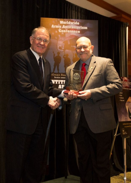 "Robert Eisenberg, Antiterrorism Officer, Fort Worth District (right), receives Award for ""Best Antiterrorism Program Manager"" from Mark Lewis, Army Deputy Chief Management Officer, Office of the Under Secretary of the Army (left) at the 2015 Annual Army Worldwide Antiterrorism Conference.  Forth Worth District also received the ""Best Antiterrorism Program -Standalone Facility"" award."