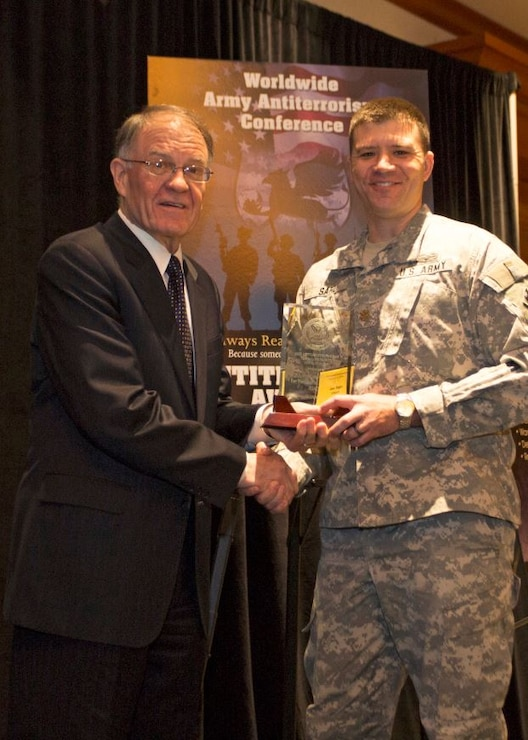 "MAJ Joe Sahl (right), Acting Chief, Emergency Management, Fort Worth District accepts award for ""Best Antiterrorism Program - Standalone Facility"" on behalf of Fort Worth District Commander, from Mark Lewis, Army Deputy Chief Management Officer, Office of the Under Secretary of the Army (left) at the 2015 Annual Army Worldwide Antiterrorism Conference."
