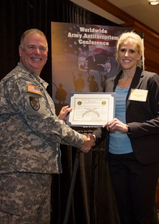 Jamie Grunner, (former) Resource Manager, Operational Protection Division, HQUSACE (right), receives AT Honor Roll Award from MG Mark Inch, Provost Marshal General (left) at the 2015 Annual Army Worldwide Antiterrorism Conference.