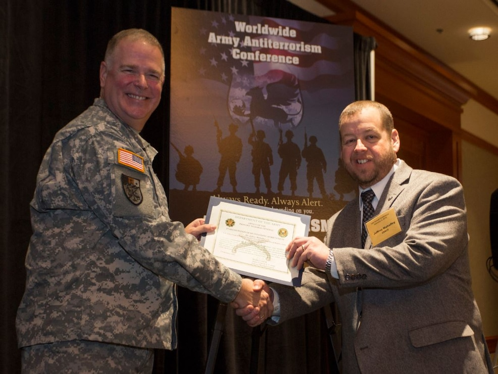 Jeffrey Mahaffey, All Hazards and Contingency Operations Program Manager, Fort Worth District (right), receives AT Honor Roll Award from MG Mark Inch, Provost Marshal General (left) at the 2015 Annual Army Worldwide Antiterrorism Conference.