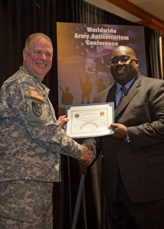 Jermaine March, Antiterrorism Officer, Philadelphia District (right), receives AT Honor Roll Award from MG Mark Inch, Provost Marshal General (left) at the 2015 Annual Army Worldwide Antiterrorism Conference.