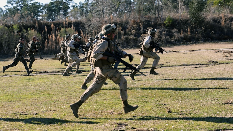 Marines with 2nd Combat Engineer Battalion, 2nd Marine Division, run to a firing point at a range here, Feb. 10, 2015. Critical Skills Operators with 3rd Marine Special Operations Battalion, U.S. Marine Corps Forces Special Operations Command, trained with 2nd CEB Marines during RAVEN 15-03, a 10-day realistic military training exercise to enhance the battalion's readiness for worldwide support to global security. Marines with 2nd CEB played the role of a partner nation force during the exercise.